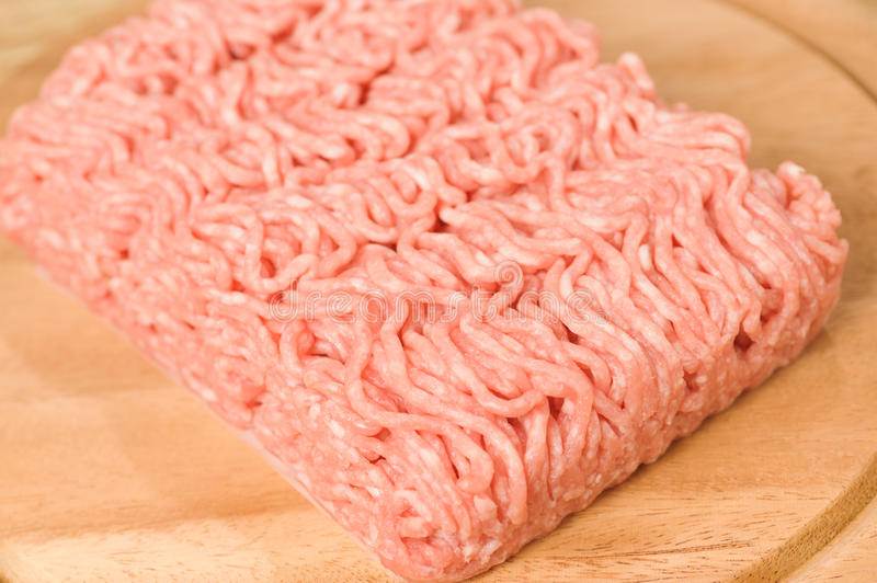 Minced meat. With parsley isolated over white stock photos