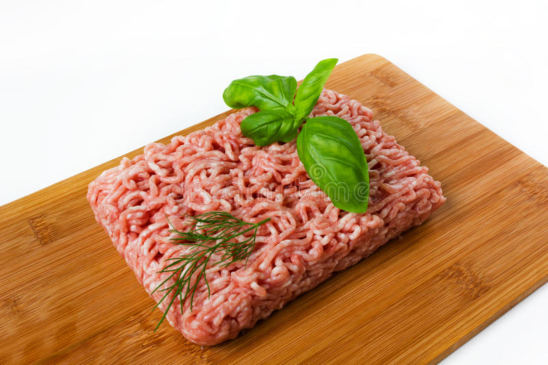 Minced Meat With Basil On A Wooded Cutting Board Stock Image
