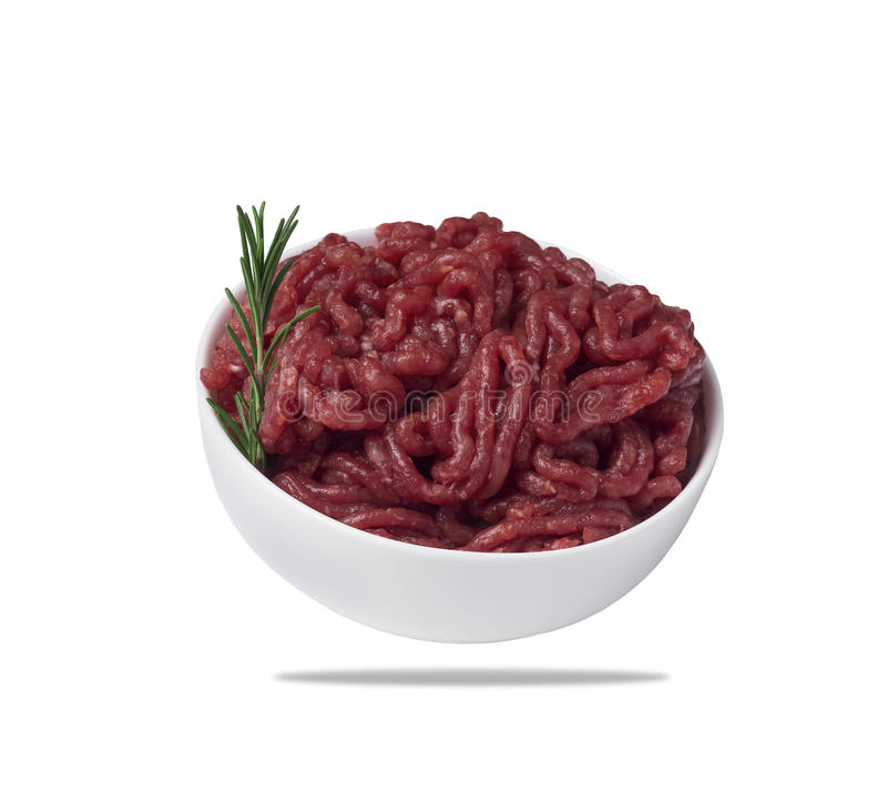 Minced meat in a bowl, isolated on a white background. stock image