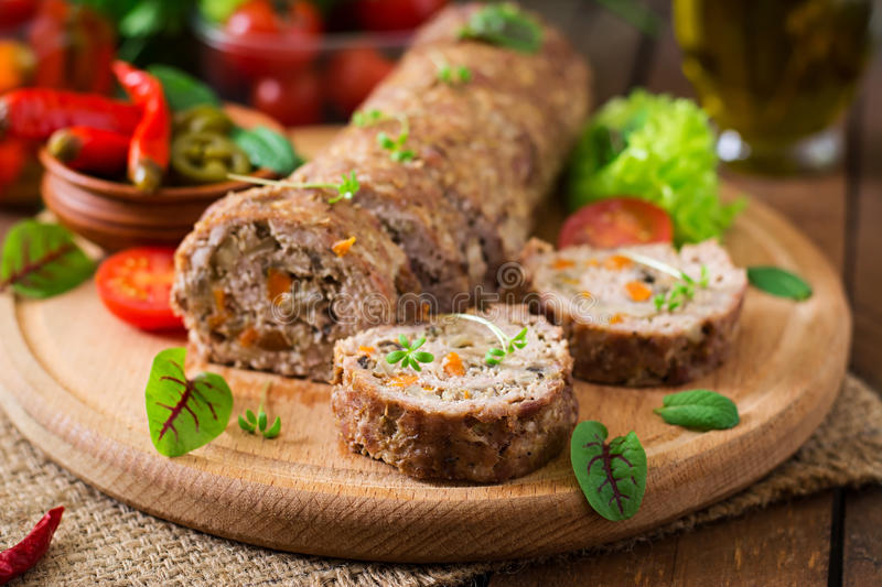 Minced meat loaf roll with mushrooms. And carrots stock photos