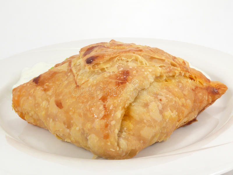Minced meat in puff pastry stock images