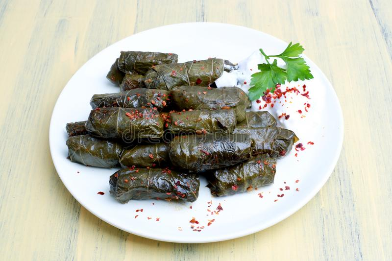Minced meat Sarma. Yaprak sarma, a food flavor in Turkish cuisine. Turkish cuisine, is one of almost every dish in the region stock photo