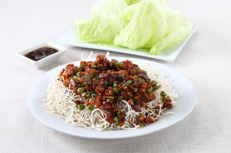 Minced pork lettuce wrap. On bed of fried noodles stock photography