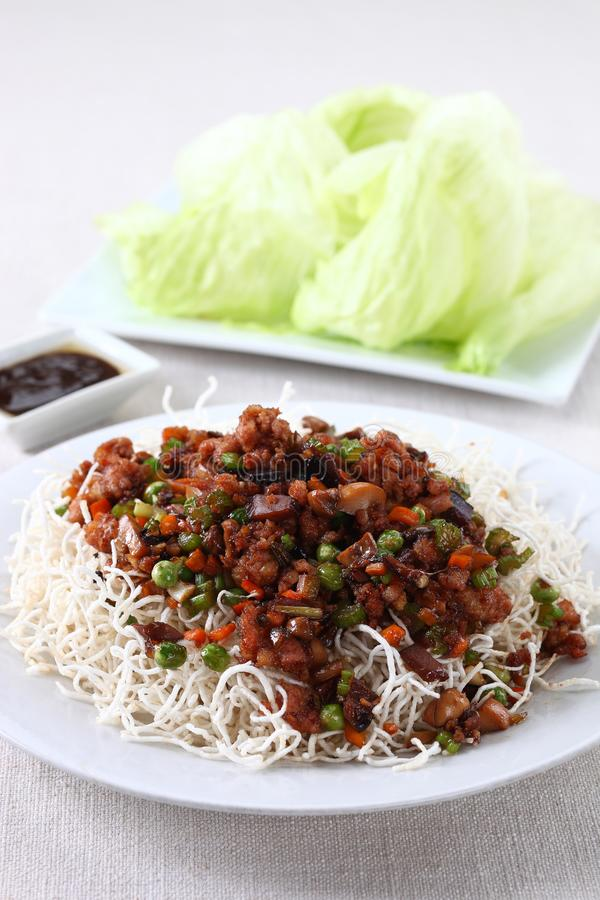 Minced pork lettuce wrap. On bed of fried noodles royalty free stock photography