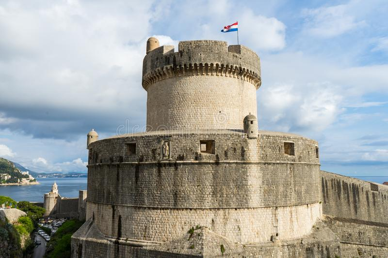 Minceta Tower at sanset lights and Dubrovnik medieval old town city walls, Croatia royalty free stock photo
