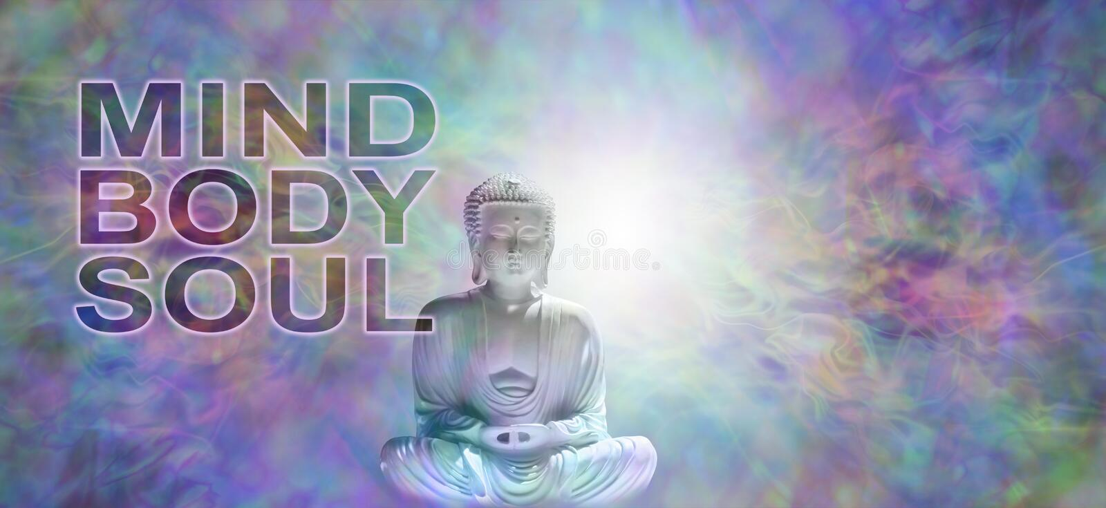 Mind Body Soul Buddha Banner. Buddha in meditative lotus position with white light behind head on a multicolored energy field background and the words MIND BODY stock photo