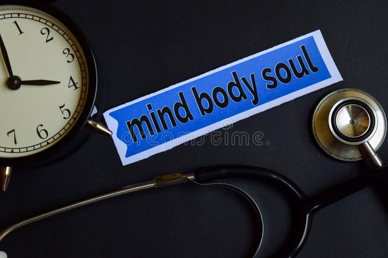Mind Body Soul on the print paper with Healthcare Concept Inspiration. alarm clock, Black stethoscope. stock image