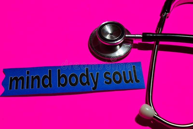 Mind Body Soul on the print paper with medicare Concept. Inspiration. Stethoscope on pink bakcground stock photos