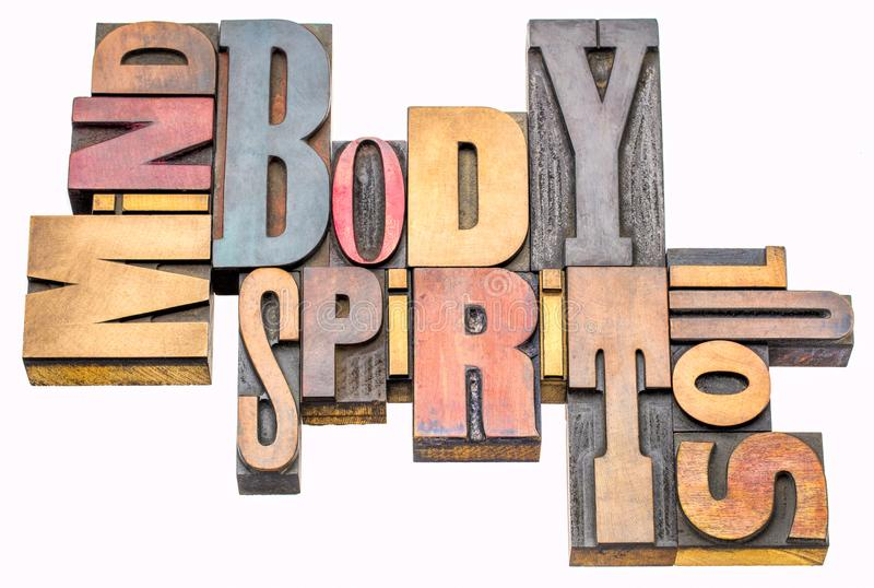 Mind, body, spirit and soul word abstract. Mind, body, spirit and soul - isolated word abstract in vintage letterpress wood type blocks stock image