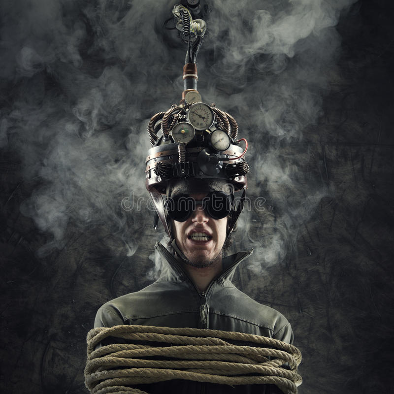 Mind control. Man wearing a brain-control helmet, human brain-related experiments stock image