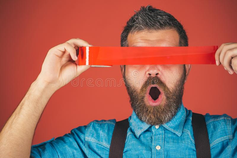 Mind control and propaganda. freedom of speech and press. censorship. Brutal bearded male. International Human Right day. Man wrap mouth by adhesive tape stock images