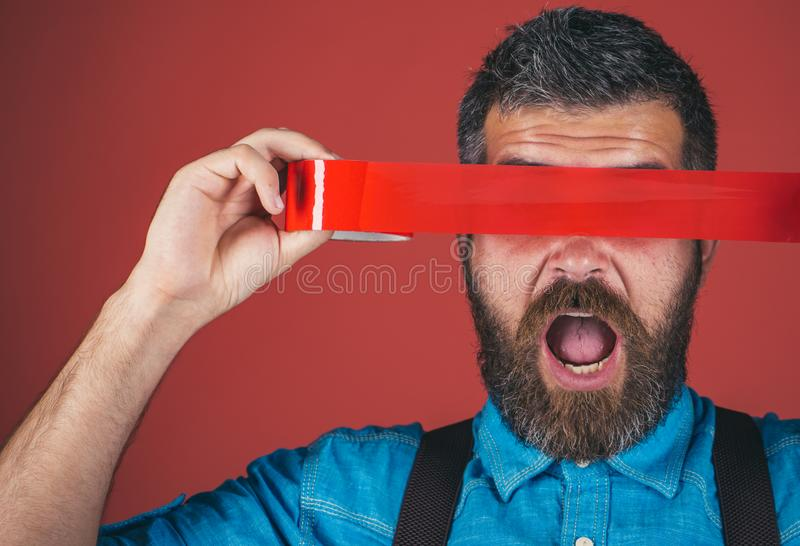 Mind control and propaganda. International Human Right day. man wrapping mouth by adhesive tape. Concept freedom of. Speech and press. censorship. Brutal royalty free stock photography