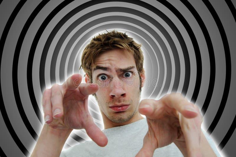 Mind Control Tactics. Image of a hypnotist brainwashing the viewer into a deep subconscious subliminal trance using secret mind control tactics stock image