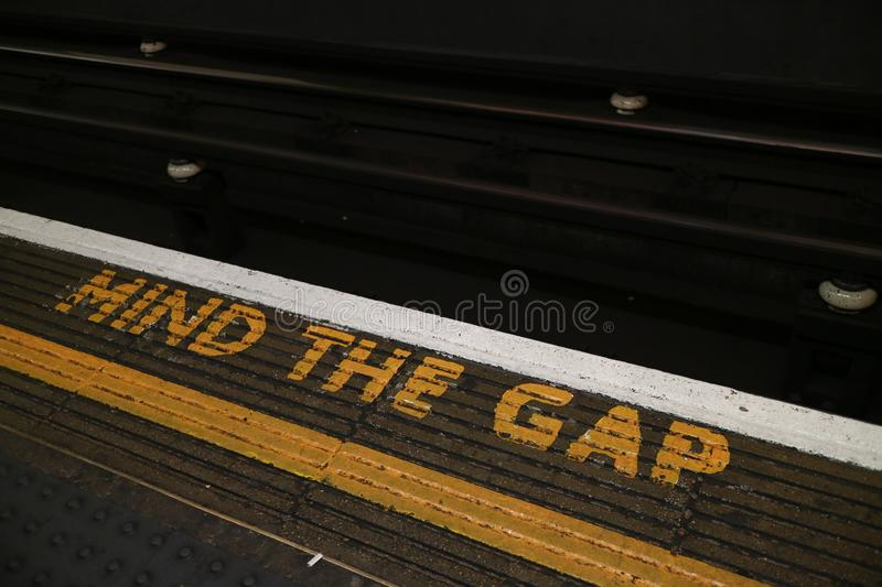 `Mind the Gap` Sign located in the London Underground. `Mind the Gap` Sign located on the London Underground platforms stock photos