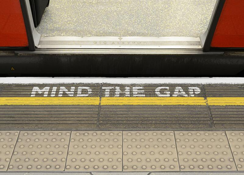 Mind the Gap Warning Sign on the Platform Edge of a London Underground Station stock photos