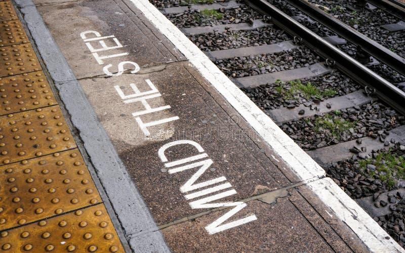 MIND THE STEP written on train platform near rails at London DLR   Docklands Light Railway  station stock photos