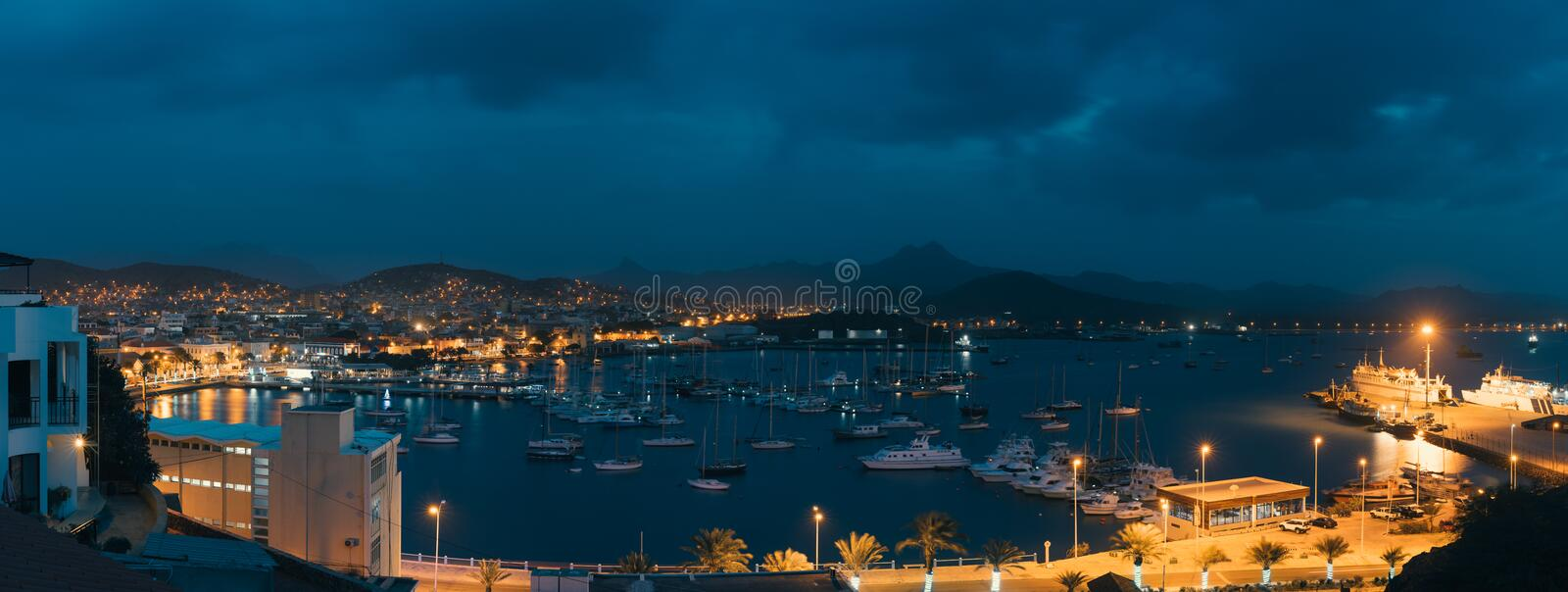Mindelo in twilight. Port town with many boats in the bay on the Cape Verde in the northern part of the island Sao royalty free stock image