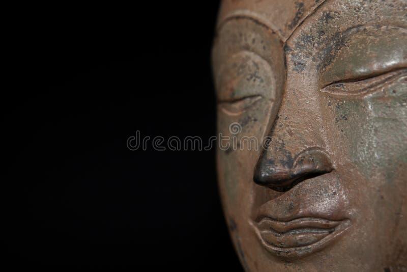 mindfulness Bedachtzame overpeinzing op het gezicht van Boedha stock afbeeldingen