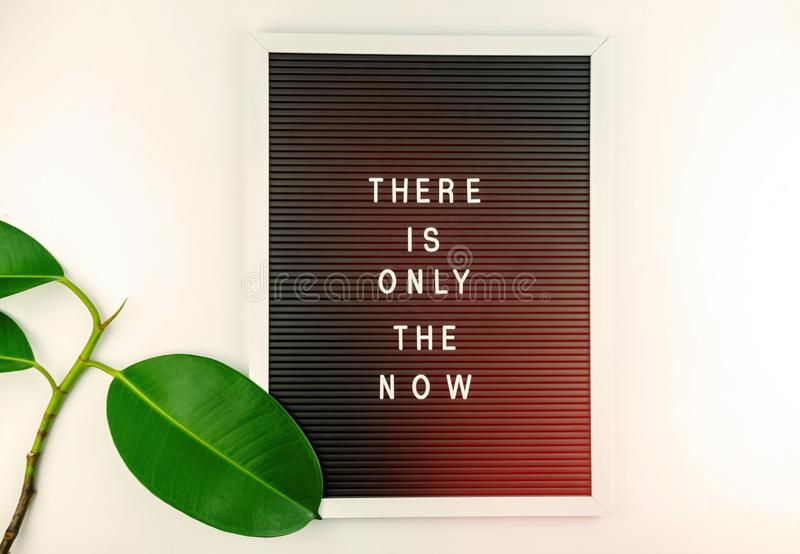 Mindfulness - do it NOW. There is only the NOW written on Letter board on white background. Mindfulness - do it NOW. There is only the NOW written on Letter royalty free stock photo