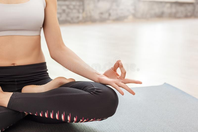 Mindfulness. Woman doing yoga at home sitting in lotus pose doing meditation half body close-up royalty free stock photos