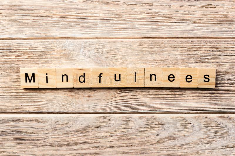 Mindfulness word written on wood block. mindfulness text on table, concept.  stock photos