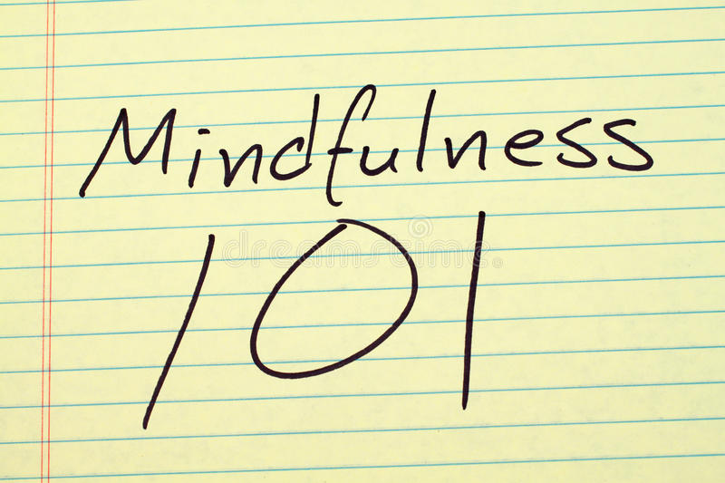Mindfulness 101 On A Yellow Legal Pad. The words `Mindfulness 101` on a yellow legal pad stock photos