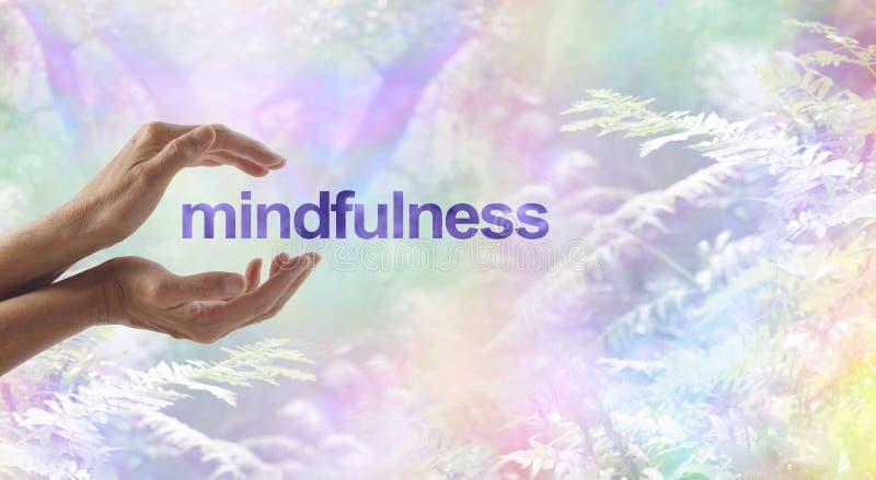 Mindfulnessmeditation som omges av den overkliga naturen royaltyfria foton