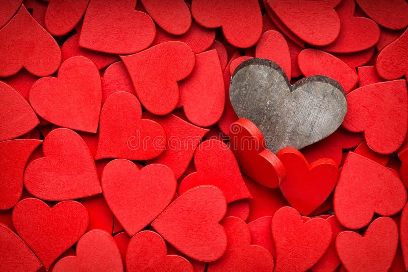 Mindre röd hjärtabakgrund royaltyfri foto