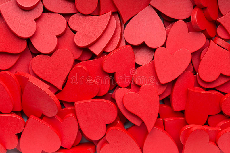 Mindre röd hjärtabakgrund arkivfoto