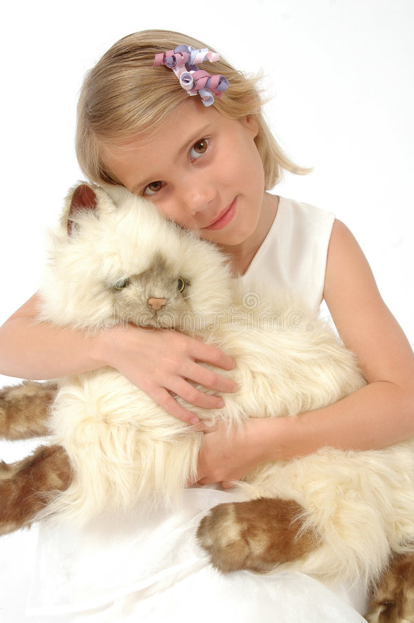 Mine. Little girl holds her stuffed animal very close and hugs it stock image