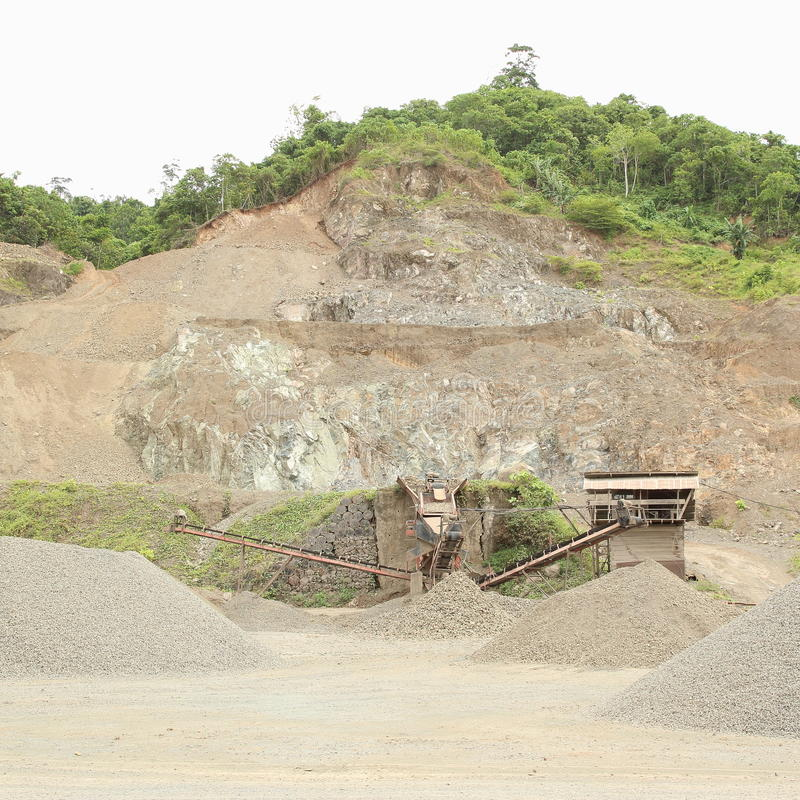 Mine. Hill with mine and mining technic near by Sorong (Papua Barat, Indonesia royalty free stock photos