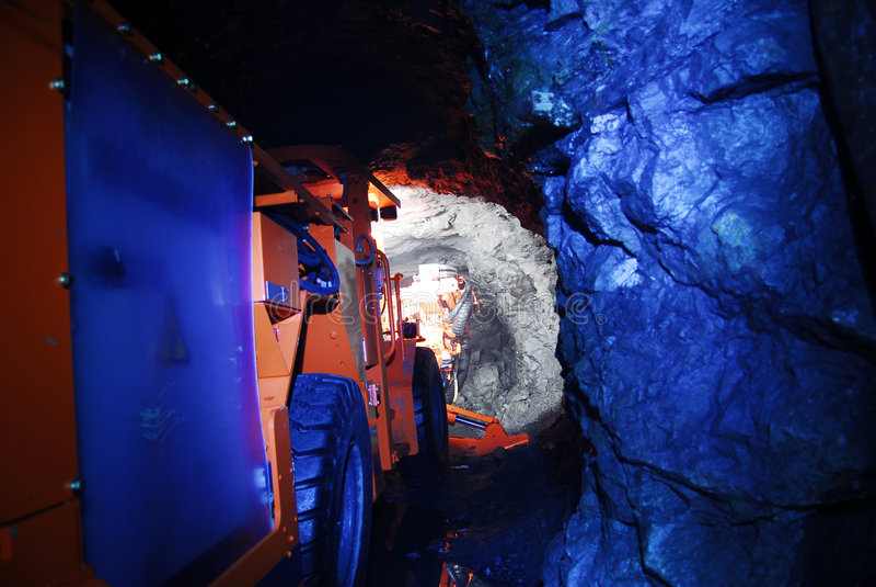 Mine machinery in mine tunnel stock image