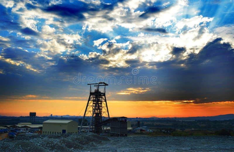 Mine shaft sunrise. A vertical mine shaft at sunrise stock photos