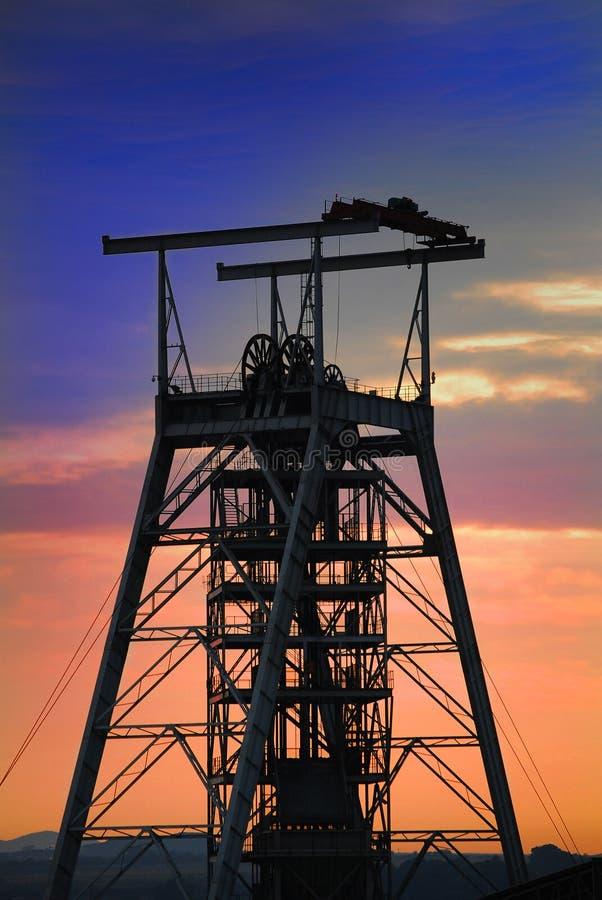 Mine shaft sunset. A vertical mine shaft at sunrise stock images
