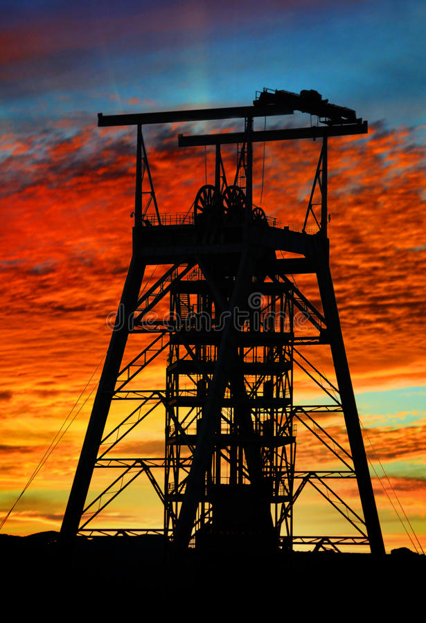 Mine shaft sunset. A vertical mine shaft at sunrise stock photos