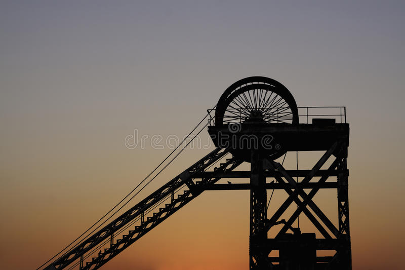 Mine shaft at sunset stock photos