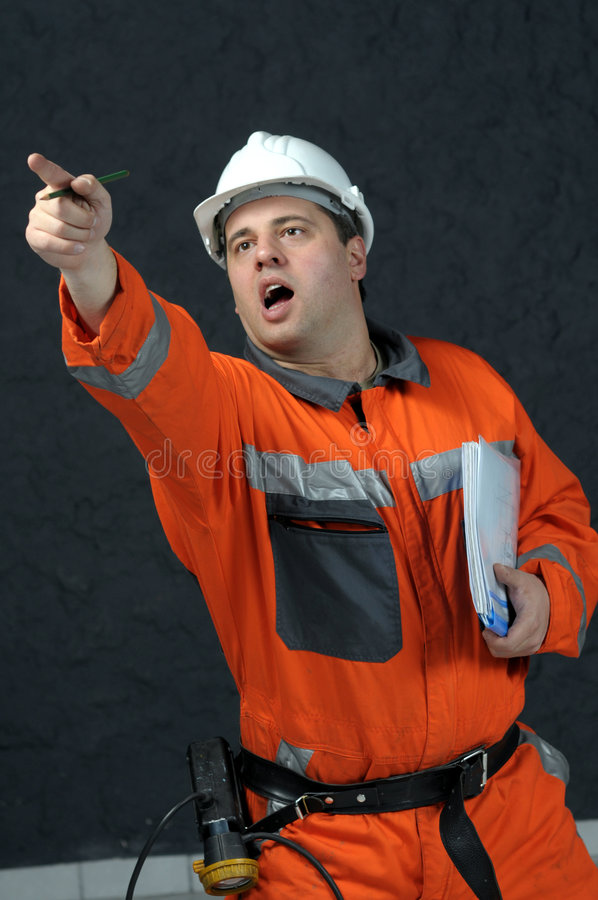 Mine worker with file. Mine worker giving directions with pointed finger royalty free stock photos