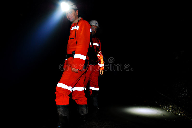 Mine workers in shaft royalty free stock images