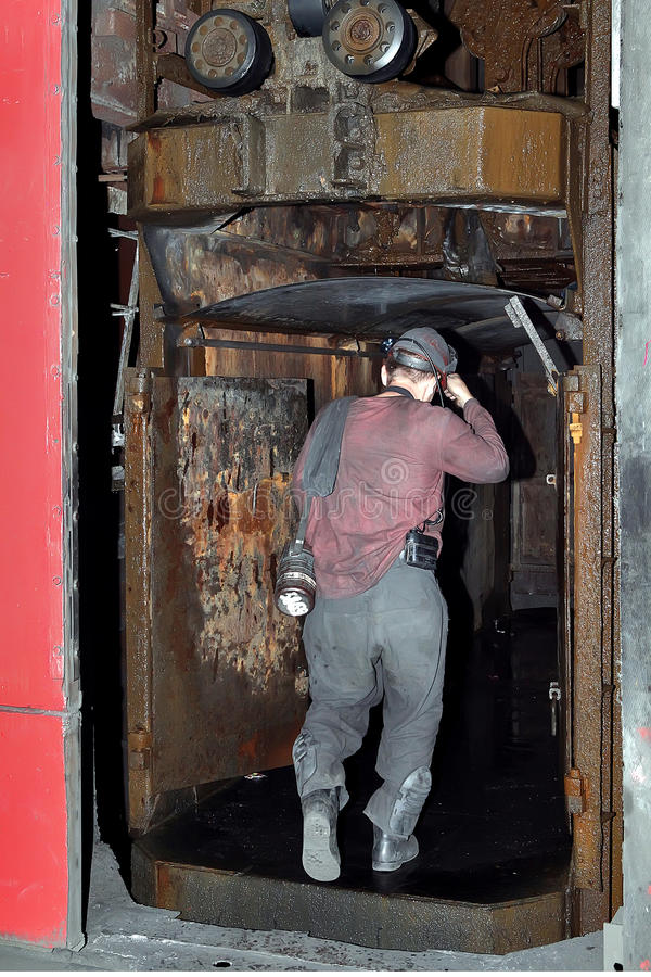 Miner down in the lift under the ground.  stock photography