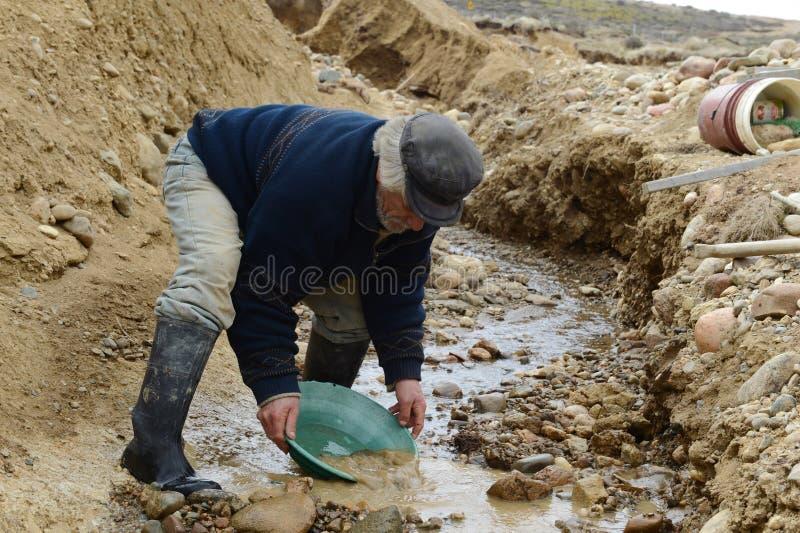 Miner washing gold in Tierra del Fuego. stock photos