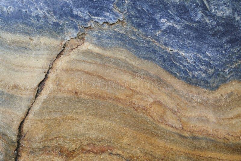Mineral background. Folded quartzite stone macro detail. Geology stock image