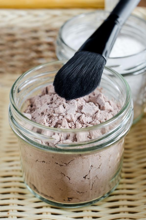 Mineral homemade powder foundation or dry shampoo in a grass jar. DIY cosmetics. Close up, copy space. royalty free stock photography