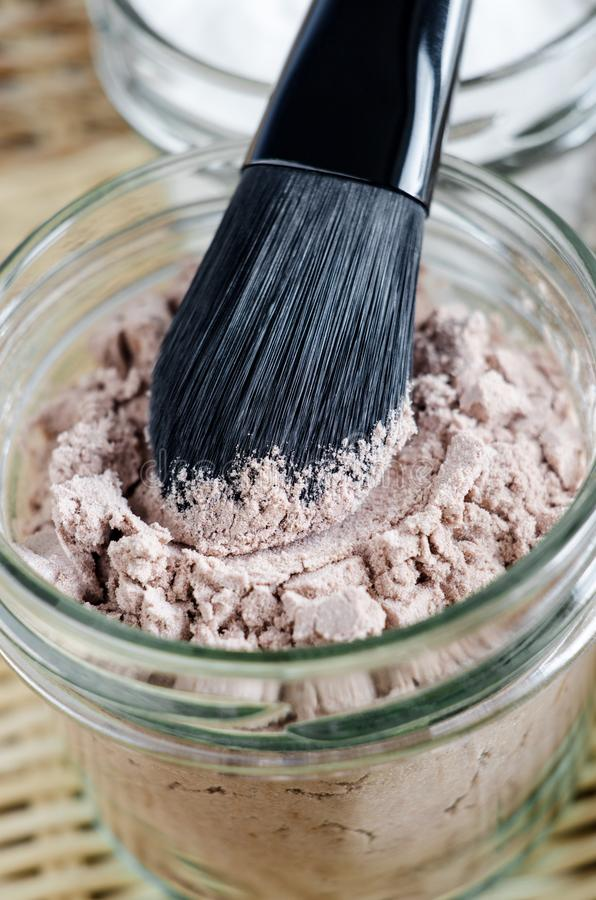Mineral homemade powder foundation or dry shampoo in a grass jar. DIY cosmetics. Close up, copy space. stock photos
