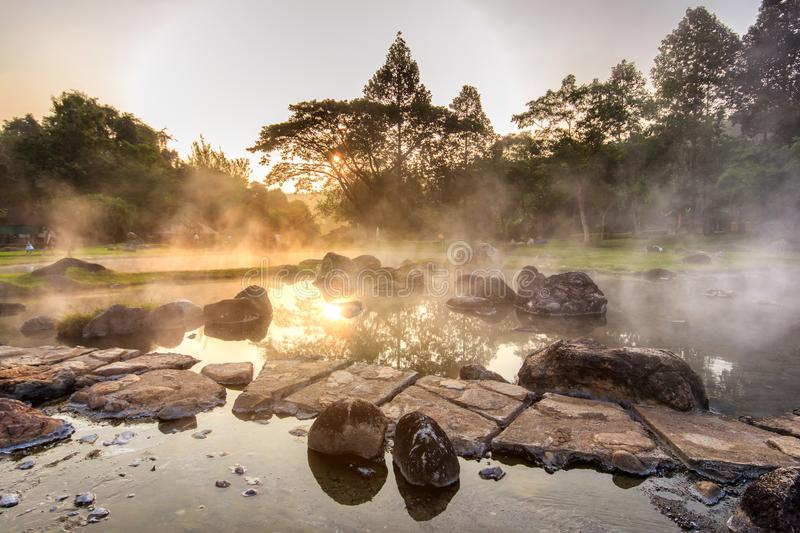 Mineral hot water in hot springs and morning fog background at Chae Son National Park. The park is also host to caves and hot springs, Lampang Province stock photography