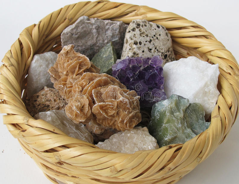 Mineral rocks in a straw basket royalty free stock photo