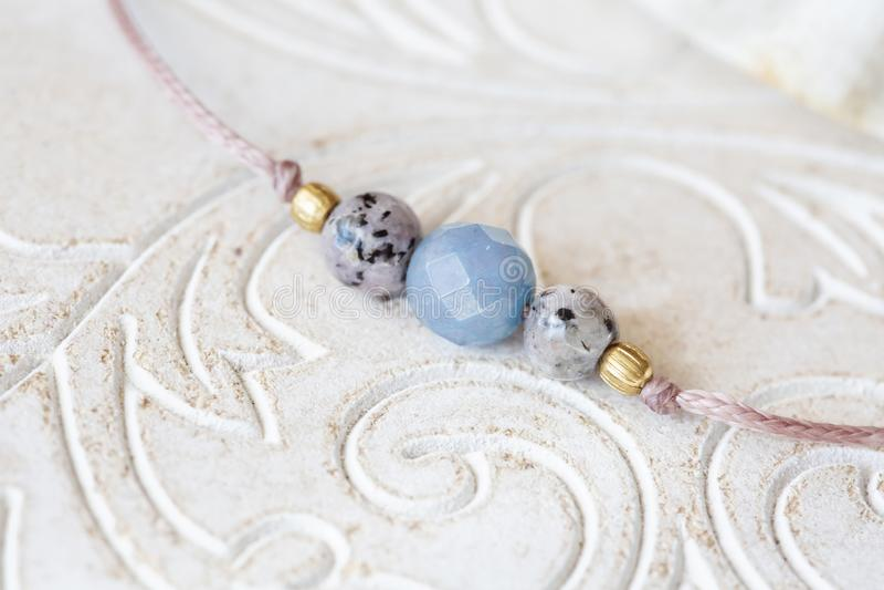 Mineral stone beads yoga bracelet detail. On decorative background royalty free stock image