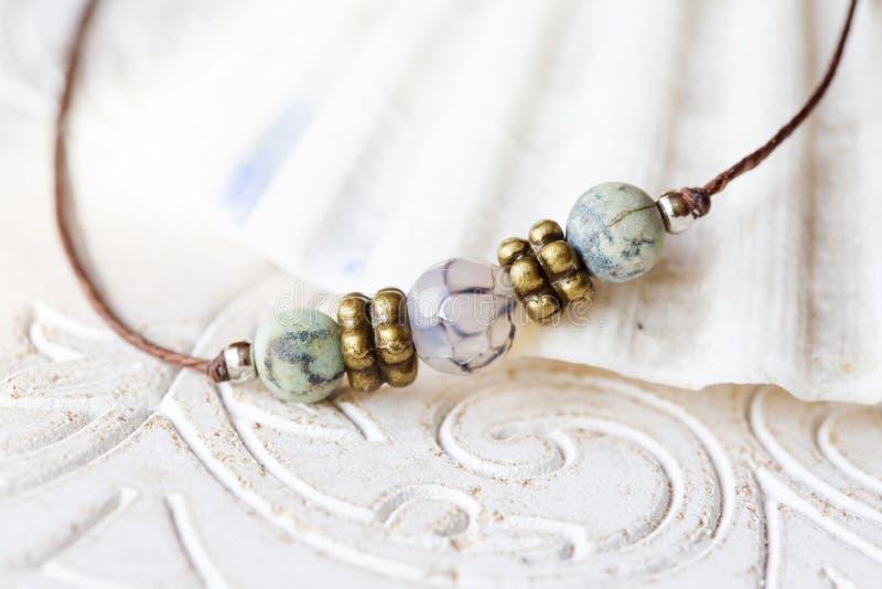 Mineral stone beads yoga bracelet detail. On decorative background royalty free stock photography