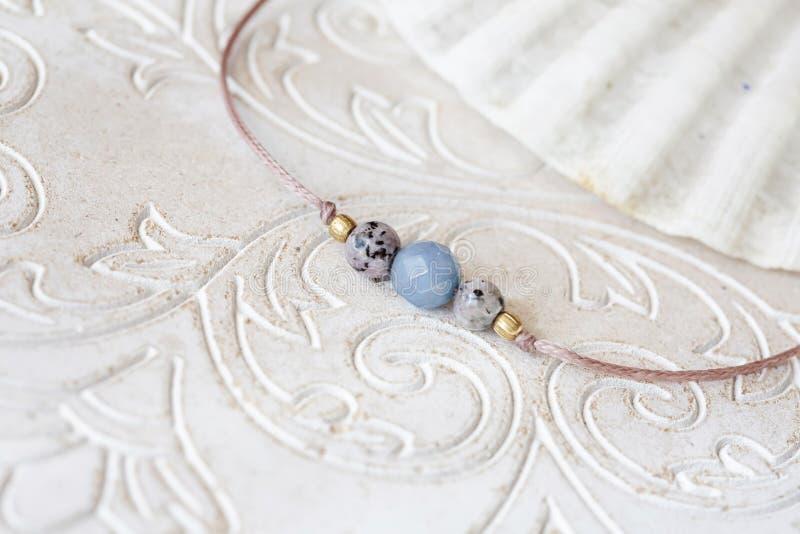 Mineral stone beads yoga bracelet detail. On decorative background stock image