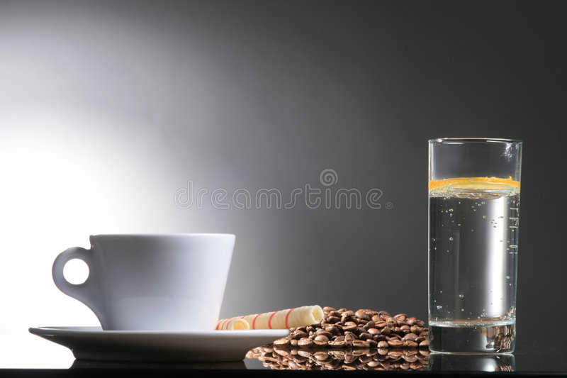 Mineral water. Coffee standing on the glass with mineral water royalty free stock photo