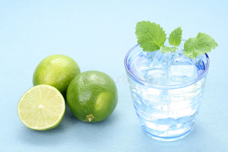 Mineral water. Glass of mineral water and fresh lime stock photography